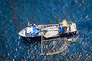 June 10, 2010 , Boat cleaning BP oil off the surface of the Gulf of Mexico.