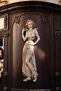 Relief sculpture of a sexy woman on a exterior wall of a restaurant and bar in Prague, Czech Republic