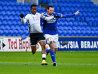 Football - 2020 / 2021 Sky Bet Championship - Cardiff City vs Swansea City - Cardiff City Stadium<br /> <br /> Jamal Lowe of Swansea challenged by Sean Morrison of Cardiff City  in a stadium without fans because of the pandemic crisis<br /> <br /> COLORSPORT/WINSTON BYNORTH