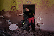 A rescue worker and a dog of the K-9 de Creixell O.N.G, from Spain, search for landslide victims in Nova Friburgo, Brazil, Thursday, Jan. 20, 2011.<br /> <br /> A series of flash floods and mudslides struck several cities in Rio de Janeiro State, destroying houses, roads and more. More than 900 people are reported to have been killed and over 300 remain missing in this, Brazil's worst-ever natural disaster.