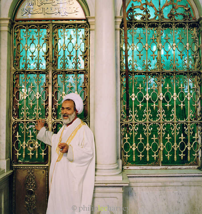 An Imam, an Islamic leader, outside John the Baptists Shrine (Shrine of Yahya Ibn Zakariyya), in the Umayyad Mosque, Damascus, Syria