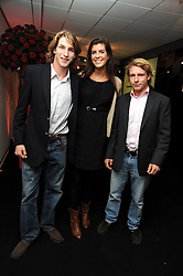 Left to right, FREDDIE HUNT, FREYA SAMUELS and TOM HUNT at the TAG Heuer British Formula 1 Party at the Mall Galleries, London on 15th September 2008.