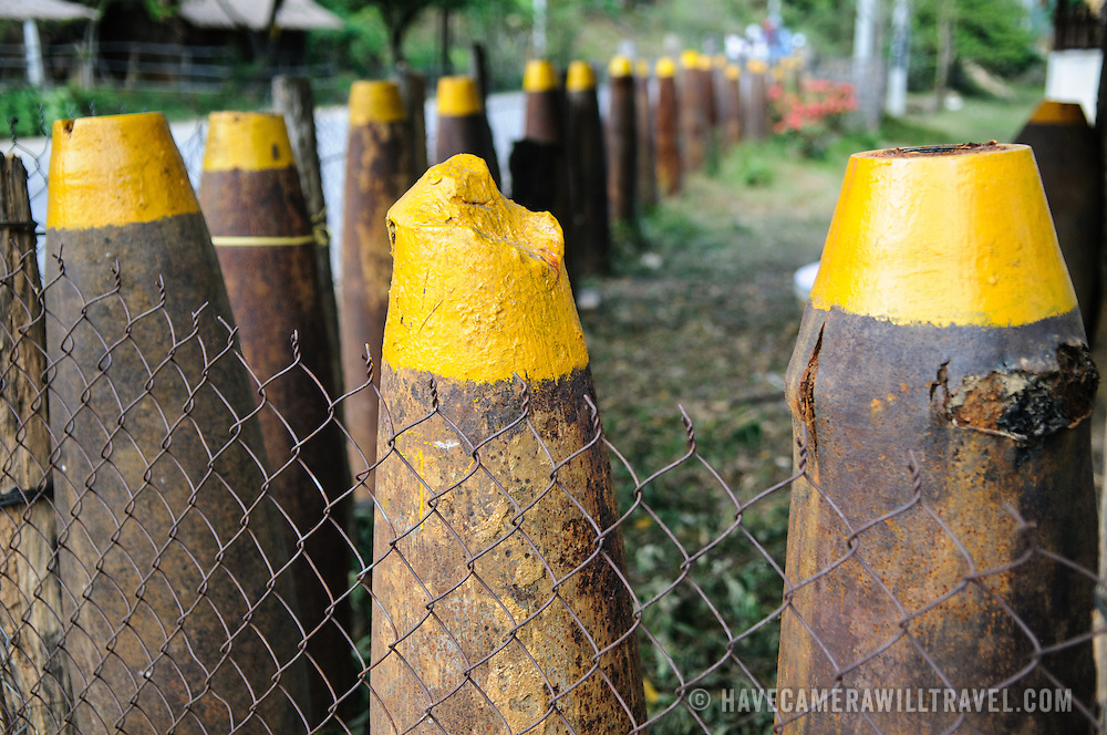 Unexploded munitions left over from the Vietnam War are used in a fence in a village in the Plain of Jars, Laos, known as Bomb Village.
