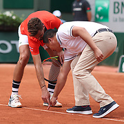 2017 French Open Tennis Tournament - Day Two.  Benoit Paire of France disputes a line call with the umpire during his match with Rafael Nadal of Spain in action on Court Suzanne-Lenglen during the Men's Singles Round one match at the 2017 French Open Tennis Tournament at Roland Garros on May 29th, 2017 in Paris, France.  (Photo by Tim Clayton/Corbis via Getty Images)