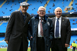 21st October 2017 - Premier League - Manchester City v Burnley - BBC Commentator John Motson stands alongside Man City Life President Bernard Halford (L) and former Man City players Mike Summerbee after receiving a special coat during a ceremony to mark his final season in the job - Photo: Simon Stacpoole / Offside.