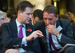 © Licensed to London News Pictures . 06/11/2014 . Leeds , UK . The Deputy Prime Minister , Nick Clegg (left) confers with economist Jim O'Neill at the Northern Futures Summit in Leeds this morning (Thursday 6th November 2014) .  . Photo credit : Joel Goodman/LNP