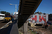 Street art view from Hackney Wick Overground station of the HW initialled Olympic Coca Cola mural in Hackney Wick, East London, United Kingdom. Street art in the East End of London is an ever changing visual enigma, as the artworks constantly change, as councils clean some walls or new works go up in place of others. While some consider this vandalism or graffiti, these artworks are very popular among local people and visitors alike, as a sense of poignancy remains in the work, many of which have subtle messages. (photo by Mike Kemp/In Pictures via Getty Images)