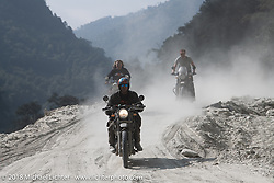 Round the World Doug Wothke, Beanre (Kevin Doebler) and Sean Lichter on a particularly dusty part of the route on Day-7 of our Himalayan Heroes adventure riding from Tatopani to Pokhara, Nepal. Monday, November 12, 2018. Photography ©2018 Michael Lichter.
