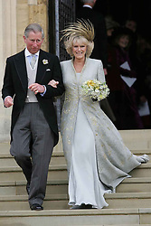File photo dated 09/04/2005 of the Prince of Wales and the Duchess of Cornwall after their Service of Prayer and Dedication at St George's Chapel as Princess Eugenie and fiance Jack Brooksbank are following in the footsteps of the Duke and Duchess of Sussex, Earl of Wessex and the Queen's eldest grandson Peter Phillips by marrying in St George's Chapel.
