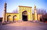 The Id Kah Mosque, Kashgar city began life in its present form in 1798, before this time it had been a place of worship during the Ming dynasty (1368-1644), built on a smaller mosque dating back to the 15th century. It is the largest mosque in western China with the purest Uighur ( a Muslim minority of Turkic origin) architecture, its colours reflecting the arid environment it inhabits. Inside it contains a large octogonal shaped pavilion and internal courtyard which can allow up to 7000 worshipers in at any one time. It is the symbol of Uighur cultural and religious presence  for the whole of the central Chinese and neighbouring Asian countries, such as Kyrgyzstan, Tajikistan, Uzbekistan, Turkestan, Afghanistan, and Pakistan.