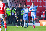 Luke Thomas of Coventry City (23) scores a goal and celebrates to make the score 2-2, to be booked by Stephen Martin (Referee) during the EFL Sky Bet League 1 match between Barnsley and Coventry City at Oakwell, Barnsley, England on 30 March 2019.