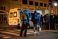 Migrants wait to get in the ambulance to take them to another shelter to sleep. Irun (Bsque Country). March 8, 2021. As the number of migrants arriving to the border city of Irun, the hostel run by the Red Cross had no room for newcomers (Gari Garaialde / Bostok Photo).
