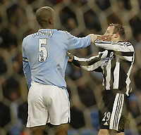 Fotball<br /> England 2004/2005<br /> Foto: SBI/Digitalsport<br /> NORWAY ONLY<br /> <br /> Manchester City v Newcastle United<br /> FA Barclays Premiership.<br /> 02/02/2005.<br /> City's Sylvain Distin clashes with Newcastle's Lee Bowyer