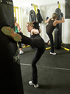 Instructor Trish English kicks a bag during a class at Club KO Kickboxing in Warwick on Dec. 24, 2008.