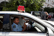 Sco0033837 .  Daily Telegraph..Policemen in the patrol car...Life returning to normality on the streets of Tripoli..Tripoli 30 August 2011. ............Not Getty.Not Reuters.Not AP.Not Reuters.Not PA....