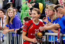 Andrea Penezic of Krim celebrate with fans Krimovci her birthday after winning the handball match between RK Krim Mercator (SLO) and RK Podravka Vegeta (CRO) in Women's EHF Champions League, on November 13, 2010 in Arena Stozice, Ljubljana, Slovenia. Krim defeated Podravka 26:22 and qualified to Main Round of Champions League. (Photo By Vid Ponikvar / Sportida.com)