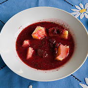 Barszcz – Polish Borscht<br /> Serves 4<br /> <br /> Ingredients: 5 beetroots<br /> 1bay leaf<br /> 25gr sausage <br /> Juice from sour cucumbers (Ogórki kiszone) <br /> Smetana to taste <br /> 2 drops maggi<br /> ½ onion<br /> butter <br /> 3 potatoes <br /> salt and pepper to taste<br />  <br /> Preparation :<br /> 1.Peel the beetroots the onion and the potatoes<br /> 2.Add in a saucepan the beetroots, the sausage and the bay leaf<br /> 3.Bring to boil and then simmer for 30mins<br /> 4.In a separate pot boil the potatoes until soft<br /> 5.Finely chop the onion<br /> 6.In a frying pan fry the onion with butter until brown <br /> 7.Slice the beetroots add the juice from the cucumbers, smetana and the onion<br /> 8.Serve with hot potatoes