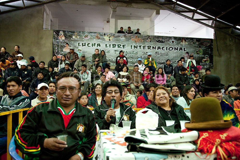 Compares and MCs of wrestling match watching. Lucha Libre wrestling origniated in Mexico, but is popular in other latin Amercian countries, including in La Paz / El Alto, Bolivia. Male and female fighters participate in the theatrical staged fights to an adoring crowd of locals and foreigners alike.