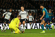 George LONG makes a save t the feet of the oncoming Martyn Waghorn during the EFL Sky Bet Championship match between Derby County and Hull City at the Pride Park, Derby, England on 18 January 2020.