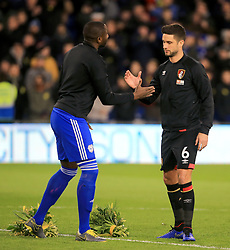 Cardiff City's Souleymane Bamba (left) and Bournemouth's Andrew Surman place flowers on the pitch ahead of the match in remembrance of Emiliano Sala during the Premier League match at the Cardiff City Stadium.