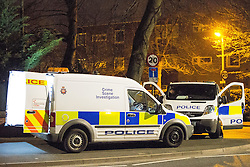 © Licensed to London News Pictures . 18/04/2016 . Cheadle , Manchester , UK . Police and forensic scenes of crime officers at a semi-detached house at 39 Cheadle Road , Cheadle Hulme , opposite Cheadle College , where a woman was found stabbed to death this evening (18th April 2016) . A 39-year-old man has handed himself in to police following a police manhunt . Photo credit : Joel Goodman/LNP