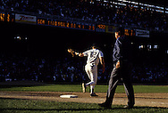 """CHICAGO, IL-SEPTEMBER 30, 1990:  """"Old"""" Comiskey Park, home of the Chicago White Sox from 1910 thru 1990.  It was demolished in 1991.  Steve Lyons of the Chicago White Sox makes the final putout to end the final game played at Old Comiskey Park on September 30, 1990.  (Photo by Ron Vesely)"""