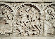 Scenes from the life of Christ, the work of the sculptor Nicholaus, on the main portal  of the 12th century Romanesque Ferrara Duomo, Italy .<br /> <br /> Visit our ITALY PHOTO COLLECTION for more   photos of Italy to download or buy as prints https://funkystock.photoshelter.com/gallery-collection/2b-Pictures-Images-of-Italy-Photos-of-Italian-Historic-Landmark-Sites/C0000qxA2zGFjd_k<br /> If you prefer to buy from our ALAMY PHOTO LIBRARY  Collection visit : https://www.alamy.com/portfolio/paul-williams-funkystock/ferrara.html