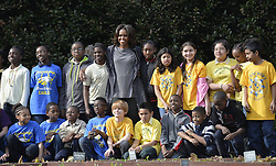 61338000<br /> U.S. First Lady Michelle Obama has photos taken with local students in the White House Kitchen Garden on the South Lawn of the White House in Washington D.C., capital of the United States, April 2, 2014. U.S. First Lady Michelle Obama joined FoodCorps leaders and local students to plant the White House Kitchen Garden for the sixth year in a row, USA,  Wednesday, 2nd April 2014. Picture by  imago / i-Images<br /> UK ONLY