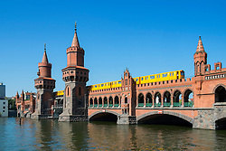 Oberbaum Bridge crossing River Spree in Berlin Germany