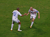 Photo: Glyn Thomas.<br />Portugal v France. Semi Final, FIFA World Cup 2006. 05/07/2006.<br /> France's Zinedine Zidane (R) celebrates after scoring his penalty with Thierry Henry.