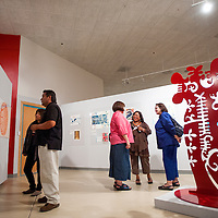 """071813       Cable Hoover<br /> <br /> Museum goers browse and talk about the art during the opening of the exhibit """"Connecting Cultures: The Four Directions"""" at the Navajo Nation Museum in Window Rock Thursday."""