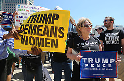As Republican presidential candidate Donald Trump speaks inside to a business crowd at the Detroit Economic Club at Cobo Center, protestors hold banners while there are a few supporters with signs expressing their opinions about the candidate and his views Monday, August 8, 2016 in downtown Detroit, MI, USA. Photo by Regina H. Boone/Detroit Free Press/TNS/ABACAPRESS.COM