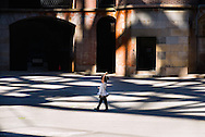 A child plays in the shadow of the Golden Gate Bridge, in the courtyard of Fort Point, San Francisco