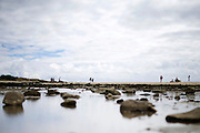 People stand on the beach of Saint Malo, Bretagne, France.<br /> <br /> © Giorgio Perottino
