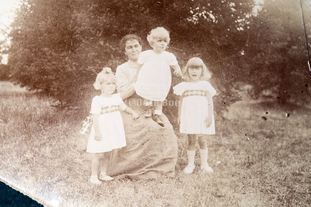 mother with little children in outdoors garden setting ca 1920s