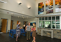 Visitors tour the front entry and Community Room following the grand opening of the Belknap County Corrections Facility on Thursday afternoon.   (Karen Bobotas/for the Laconia Daily Sun)