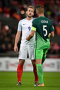 England forward Harry Kane and  Slovenia defender Bostjan Cesar  during the FIFA World Cup Qualifier match between England and Slovenia at Wembley Stadium, London, England on 5 October 2017. Photo by Martin Cole.