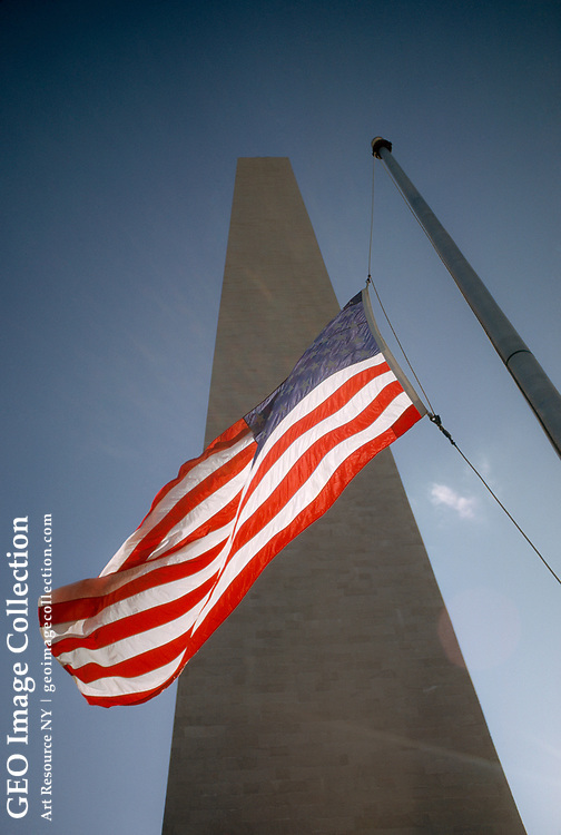 View of American flag at the base of the Washington Monument.