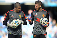 David De Gea of Manchester United ®  talking to Goalkeeper Victor Valdes of Manchester United during pre-match warm up.  Barclays Premier league match, Chelsea v Manchester Utd at Stamford Bridge Stadium in London on Saturday 18th April 2015.<br /> pic by John Patrick Fletcher, Andrew Orchard sports photography.