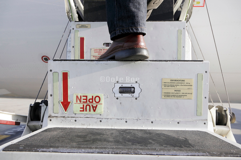 entering a small domestic commercial passengers airplane