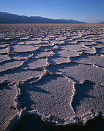 CADDV_004 - USA, California, Death Valley National Park, Polygonal patterns in salt pan on floor of Death Valley and the distant Panamint Mountains.