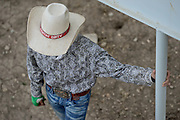 """A cowboy hat with the words """"fighting' dirty"""" is seen on a rodeo staff member during the CPRA Rodeo at the Boulder County Fairgrounds on Sunday. Go to timescall.com for more photos.<br /> <br /> Matthew Jonas / Staff Photographer Aug. 2, 2015"""