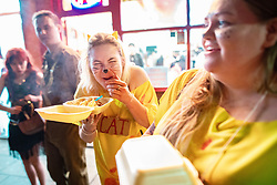 © Licensed to London News Pictures . 27/12/2018. Wigan, UK. People eat takeaway food . Revellers in Wigan enjoy Boxing Day drinks and clubbing in Wigan Wallgate . In recent years a tradition has been established in which people go out wearing fancy-dress costumes on Boxing Day night . Photo credit: Joel Goodman/LNP