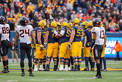 Nov 23, 2019; Morgantown, WV, USA; West Virginia Mountaineers players huddle before an offensive play during the fourth quarter against the Oklahoma State Cowboys at Mountaineer Field at Milan Puskar Stadium. Mandatory Credit: Ben Queen-USA TODAY Sports