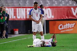 January 27, 2019 - Glendale, AZ, U.S. - GLENDALE, AZ - JANUARY 27:  Panama defender Francisco Palacios (2) stands over Panama forward Abdiel Arroyo (18) after he is injured during the international friendly soccer game between Panama and the United States on January 27, 2019 at State Farm Stadium in Glendale, Arizona. (Photo by Kevin Abele/Icon Sportswire) (Credit Image: © Kevin Abele/Icon SMI via ZUMA Press)