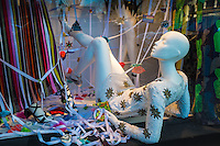 A Mannequin relaxes in the window of Bergdorf Goodman, Fifth Avenue, New York.