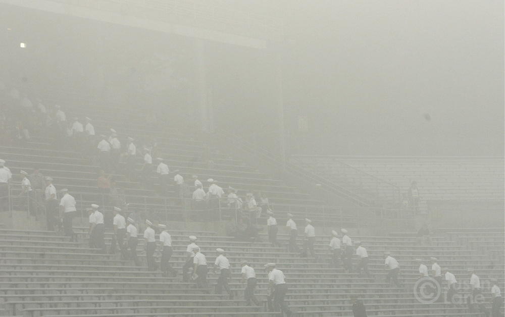 epa00724065 Military academy cadets file into foggy stands before the start of graduation ceremonies, where United States President George W. Bush was to deliver the commencement address, at the United States Military Academy in West Point , New York on Saturday 27 May 2006.  EPA/JUSTIN LANE
