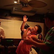 Asian tourists sing in a bar at White Beach, Boracay Island, the Philippines on October 3, 2008, Photo Tim Clayton.....Asian tourists at White Beach, Boracay Island, the Philippines...The 4 km stretch of White beach on Boracay Island, the Philippines has been honoured as the best leisure destination in Asia beating popular destinations such as Bali in Indonesia and Sanya in China in a recent survey conducted by an International Travel Magazine with 2.2 million viewers taking part in the online poll...Last year, close to 600,000 visitors visited Boracay with South Korea providing 128,909 visitors followed by Japan, 35,294, USA, 13,362 and China 12,720...A popular destination for South Korean divers and honeymooners, Boracay is now attracting crowds of tourists from mainland China who are arriving in ever increasing numbers. In Asia, China has already overtaken Japan to become the largest source of outland travelers...Boracay's main attraction is 4 km of pristine powder fine white sand and the crystal clear azure water making it a popular destination for Scuba diving with nearly 20 dive centers along White beach. The stretch of shady palm trees separate the beach from the line of hotels, restaurants, bars and cafes. It's pulsating nightlife with the friendly locals make it increasingly popular with the asian tourists...The Boracay sailing boats provide endless tourist entertainment, particularly during the amazing sunsets when the silhouetted sails provide picture postcard scenes along the shoreline...Boracay Island is situated an hours flight from Manila and it's close proximity to South Korea, China, Taiwan and Japan means it is a growing destination for Asian tourists... By 2010, the island of Boracay expects to have 1,000,000 visitors.