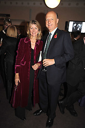 MARSHA FITZALAN-HOWARD and NICK GEORGE at a party to celebrate the publication of 'Past Imperfect' by Julian Fellowes held at Cadogan Hall, 5 Sloane Terrace, London SW1 on 4th November 2008.