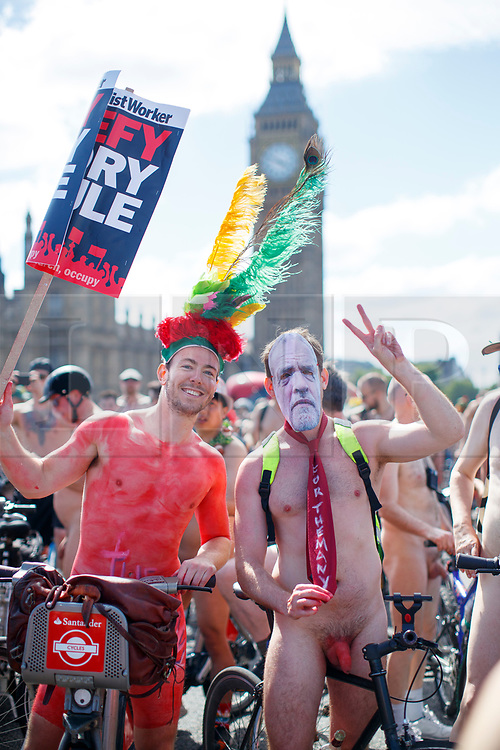 © Licensed to London News Pictures. 10/06/2017. London, UK. A man with Jeremy Corbyn mask takes park in a naked bike ride in central London on Saturday, 10 June 2017 as part of the World Naked Bike Ride event, which protests against car culture and aims to raise awareness of cyclists on the roads. Photo credit: Tolga Akmen/LNP